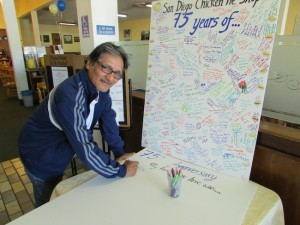 A guest signs the restaurant's anniversary card over the celebratory weekend (Photo by Morgan M. Hurley)