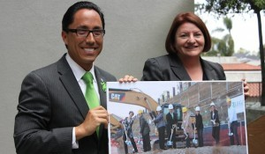 (l to r) Todd Gloria and Toni Atkins at the May 17 opening hold a picture of the Oct. 2011 groundbreaking. (Photo by Mark Davidson Photography)