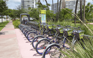 Exhibit 4.4 of the Council proposal shows a current DecoBike bicycle station in use in a different city. (Courtesy San Diego City Council)