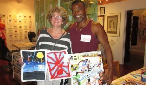 Artists at a recent Art Happy Hour show off their work. (Courtesy Trish Sjoberg)