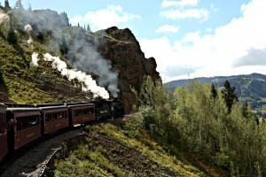 A train chugs along the hillside on the Cumbres & Toltec Scenic Railroad. (Photo by Ron Stern)