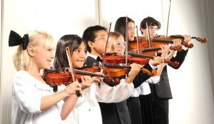 Children in the Mainly Mozart's Youth Orchestra perform during their 2012 season (Photo by Ling Zhu).