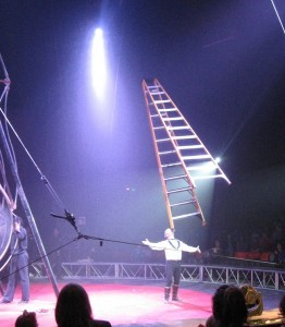 Jon Weiss of Circus Vargas balancing a 12-foot step ladder on his chin (Photo by Andy Hinds)