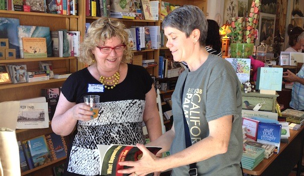 "(l to r) Author Bonnie ZoBell answers a question from Jill Paisley about her book ""What Happened Here"" at The Grove in South Park during California Bookstore Day, May 3. (Photo by Melanie Peters)"