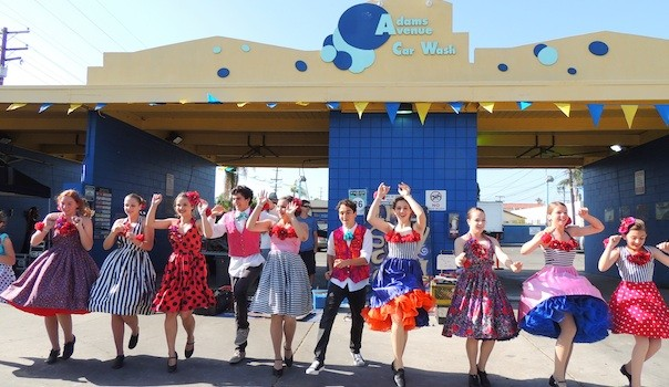 "Members of the San Diego Junior Theater perform a ""spring swing dance"" in front of the Adams Avenue Car Wash at Art Around Adams. (Photo by Cynthia Robertson)"