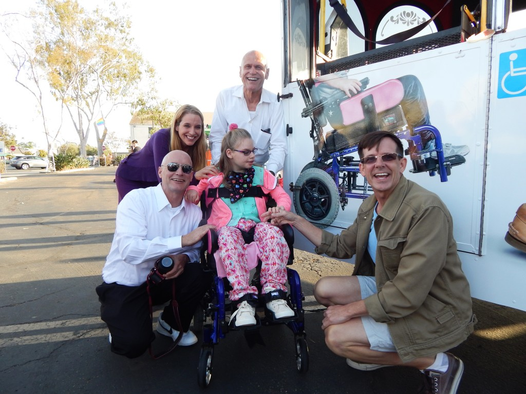 (l to r) Ian Gladd, Bernadette Gladd, Lily Gladd, John Thurston and Chet Sewell next to Lily's image on the trolley (Photo by Vince Meehan)