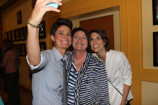 Assembly Speaker Toni Atkins takes a selfie with two attendees of her celebration at The Center. (Photo by Benny Cartwright)