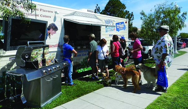 Dog owners and their furry companions line up for treats at Milo's Kitchen Treat Truck as it rolled through San Diego in early July. (Photo by Monica Medina)