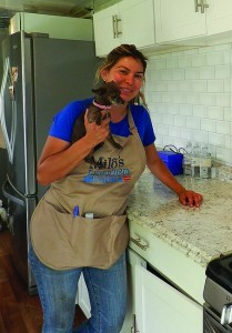 Milo's Kitchen tour manager Elena Martinez and her dog Bella (Photo by Monica Medina)