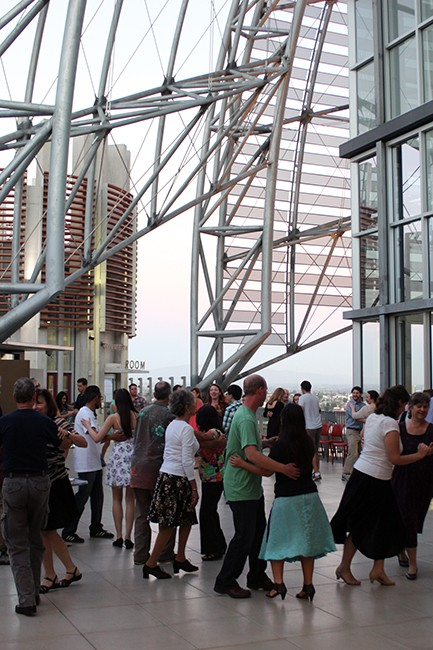 A recent Monday evening, some 50 people gathered on the library's ninth-floor patio under the dome for a free swing dance lesson with local instructor Jackie O'Neil Plys. (Photo by Jeremy Ogul)