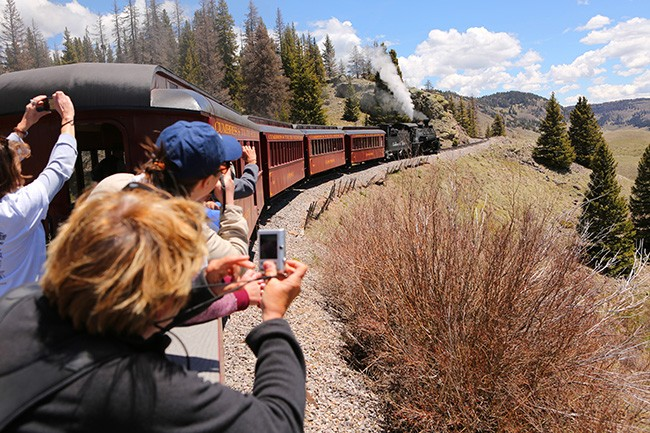 Tourist aboard the Cumbres & Toltec Scenic Railroad train can enjoy heart-stopping scenery in an open car (Photo by Ron Stern)