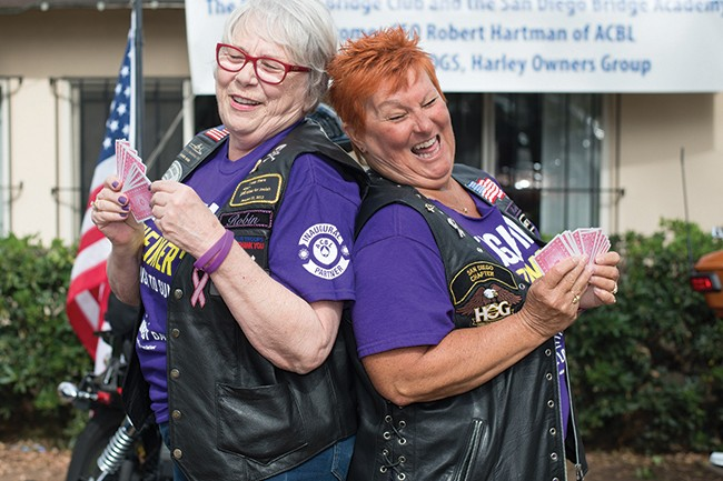 Trish White (left) and members of her bridge club will play bridge all day on The Longest Day while Robin Parker (right) and members of San Diego HOG ride Harleys around area bridges to raise money for Alzheimer's research. (Photo by Mike Lewis)