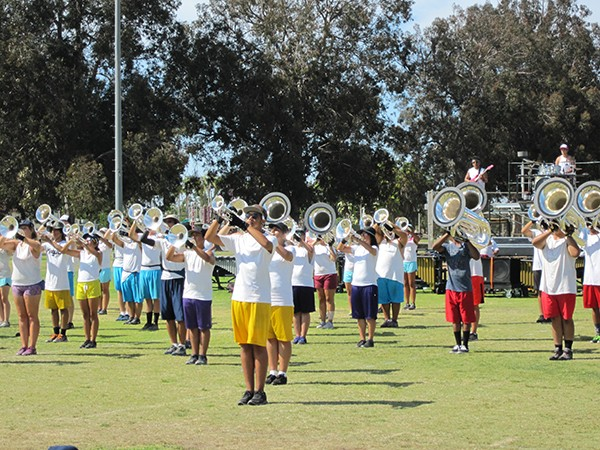 The horn section of Gold Drum and Bugle Corps play it loud and proud at Morley Field as they prepare for their upcoming national competition. (Courtesy of Katherine Hon)