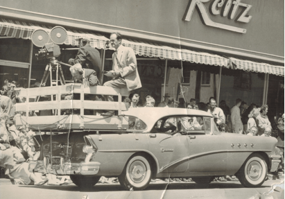 Joe Maestro (left, behind announcers) filming a parade in the mid-1950s (Photo courtesy of Pat Maestro)