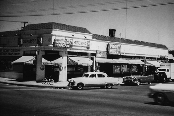 This 1955 photo shows the Piggly Wiggly store that opened at the corner of 30th and Juniper streets in the 1920s. The building is now home to the Daily Scoop and The Grove's recent split into South Park Dry Goods Company and the West Grove Collective. (Courtesy of Vicki Granowitz.)