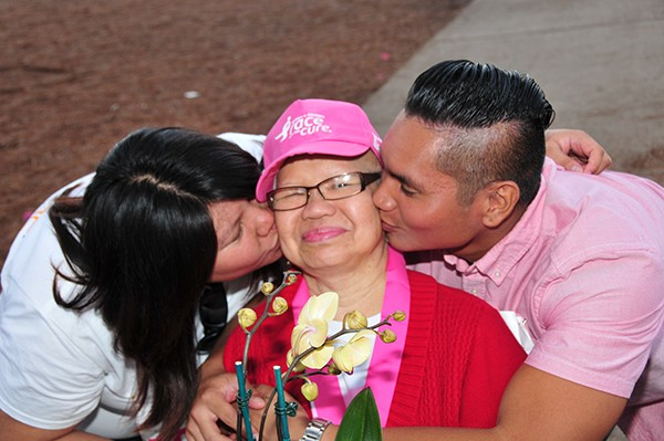 A breast-cancer survivor gets some loving at a previous Komen San Diego Race for the Cure. (Photos courtesy of Komen San Diego)