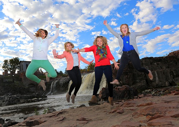 "Tourists ""jump"" at the falls on the Big Sioux River in Sioux Falls, South Dakota. Photos by Ron Stern)"