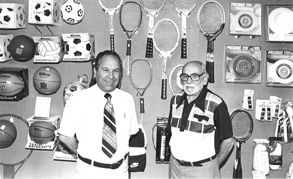 (l to r) Joe Schloss and his father, David, pose at their store counter in 1970. (Courtesy of Joe Schloss)