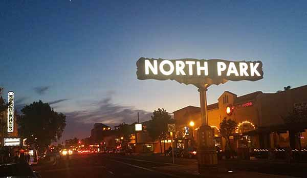 The iconic North Park sign on University Avenue, seen at dusk (Photo by Ken Williams)