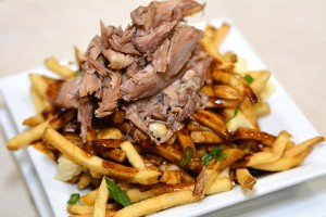 Duck confit poutine and other new dishes are in the works at Pardon My French Bar and Kitchen, which will replace Heat Bar and Kitchen. (Courtesy of the Delfe Group)