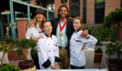 (back, l to r) Chef Julie Darling of Just Calls Us Volunteers and Chef Chris Decker with (front) two student chef volunteers at Mama's Day 2015. (Courtesy of Decker Brothers Gourmet Soup)
