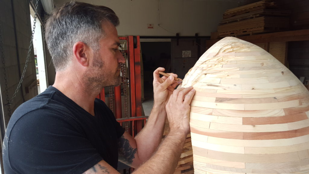 "Artist Aaron Cathcart working on an isolation ""egg"" chair (Photo by Victoria Jones)"