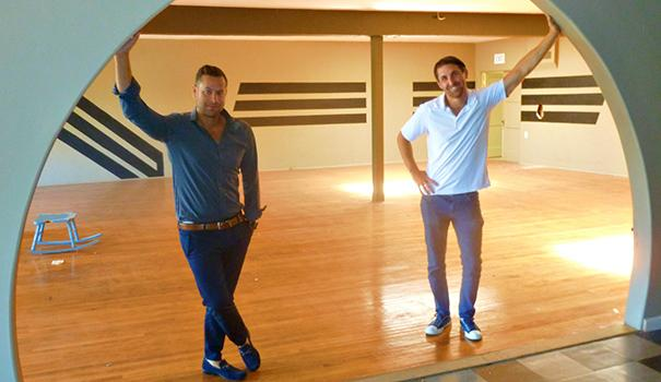 (l to r) Daniel Shkolnik and Brandon Blum stand in front of a second-floor dance floor from the Flapper-era. (Photo by Frank Sabatini Jr.)