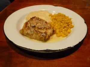 Walnut-crusted white sea bass in lemon sauce with corn and mashed