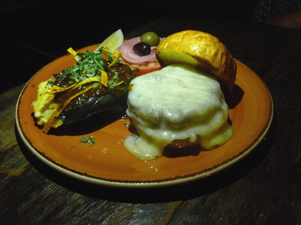 The house burger swathed in aged, white cheddar (Photo by Frank Sabatini Jr.)