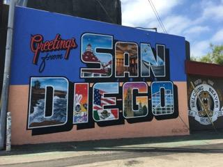 Greetings Inc. is run by a couple of guys who travel across the United States scoping out landmarks of big cities and incorporating them into Post Card murals. (Photo by Kathleen Hughart)