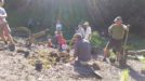 Peter H. St. Clair, with Friends of Mission Hills Canyons, demonstrates his technique for planting native plants in the canyon. (Courtesy of Peter H. St. Clair)