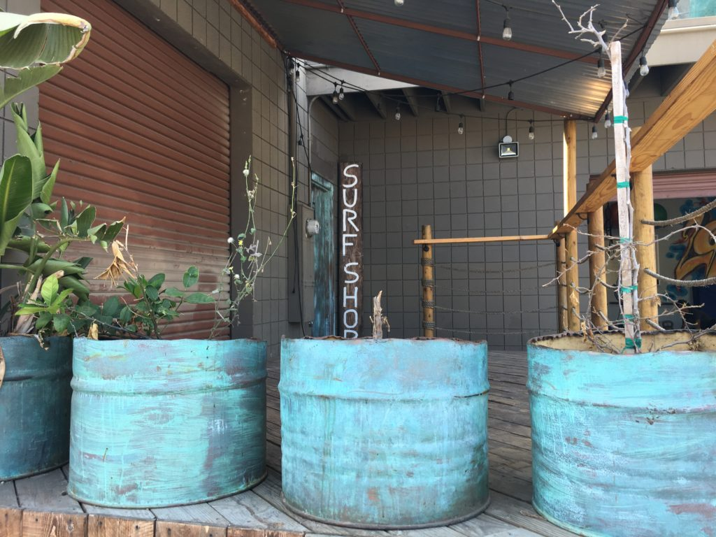 Planters beautify a deck facing the alley outside Shaper Studio. (Photo by Kathleen Hughart)