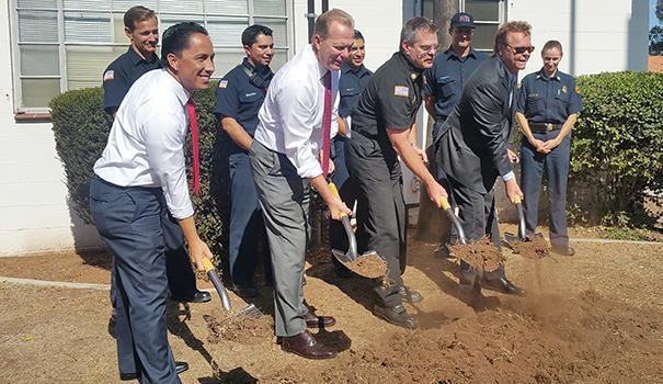 (l to r) Firefighters watch as District 3 Councilmember Todd Gloria, Mayor Kevin L. Faulconer, Fire-Rescue Chief Brian Fennessy and Hillcrest Town Council past chair Luke Terpstra break ground on new fire station in Hillcrest. (Photo by Ken Williams)
