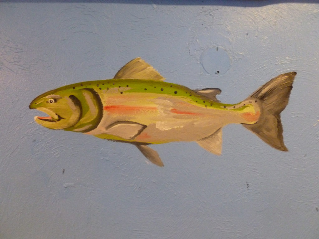 Fish paintings accent the dining room walls