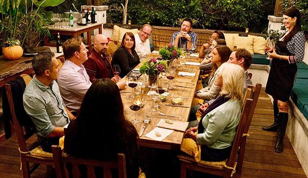 Hostess Audrey Jacobs, right, engages guests in conversation at a recent supperclub dinner at a home in South Park. (Courtesy of Culinary Hedonism Supper Club)