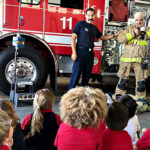 First-graders see fire station spring into action