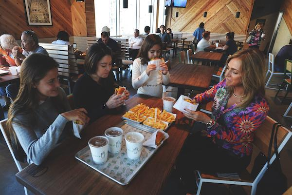 Guests Enjoy Shake Shack Burgers Fries And Shakes For Lunch