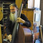 Friends tied together by double bass